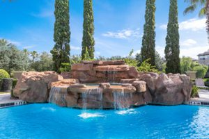 Large resort pool and rock fountain